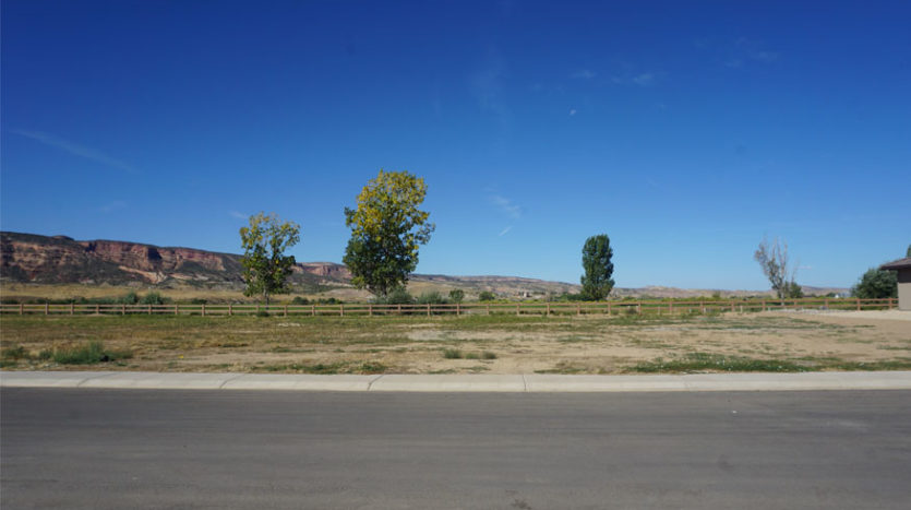 1369 Fairway Drive is a vacant lot in Fruita CO. It is located on the west perimeter of Adobe Falls, backin gup to the Adobe Creek National Golf Course.