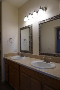 The master bath has a double sink vanity, and private toilet/shower room.