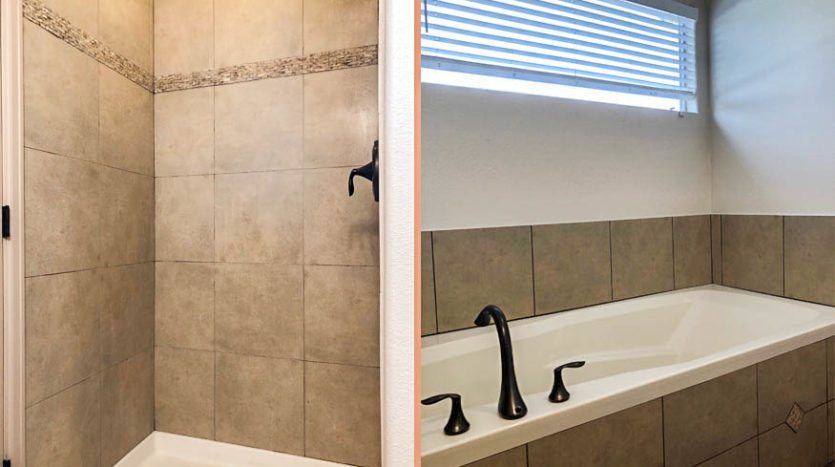 The master bath of 191 Winter Hawk includes a rectangular soaking tub and step-in shower.