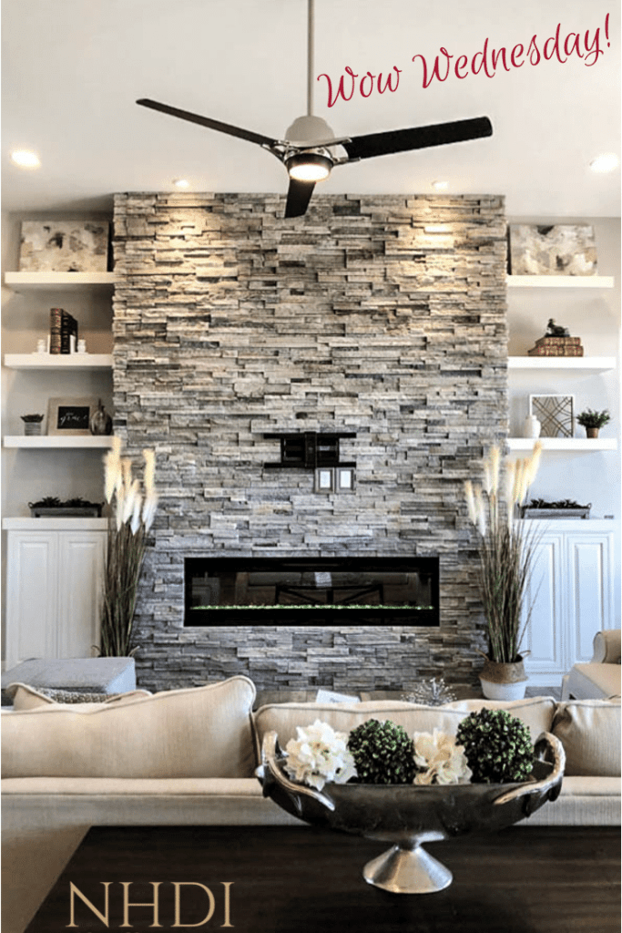 Gorgeous stone-wrapped fireplace in a home in Adobe Falls Subdivision in Fruita, CO