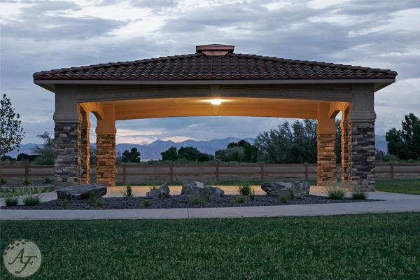 Adobe Falls Park gazebo at dusk with the lights on.