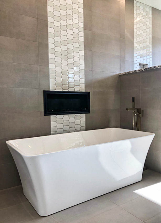 Stand-alone soaking tub with a gas fireplace next to it. The perfect solution to a cold bathroom! Home built by Alegria Home Builders in Grand Junction, CO.
