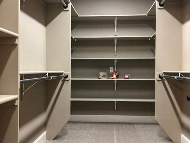 The master closet offers options for shelving and hanging space.