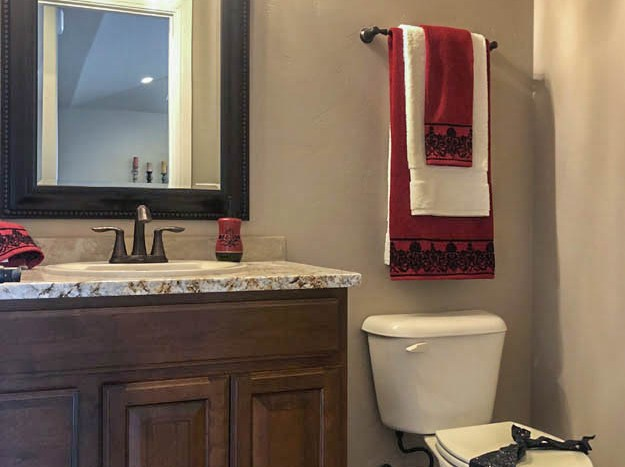 Half bath for guests in 1329 Niblick Way, Fruita.