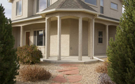 The corner gazebo on 2996 Osprey Way has a flagstone pathway leading to it.