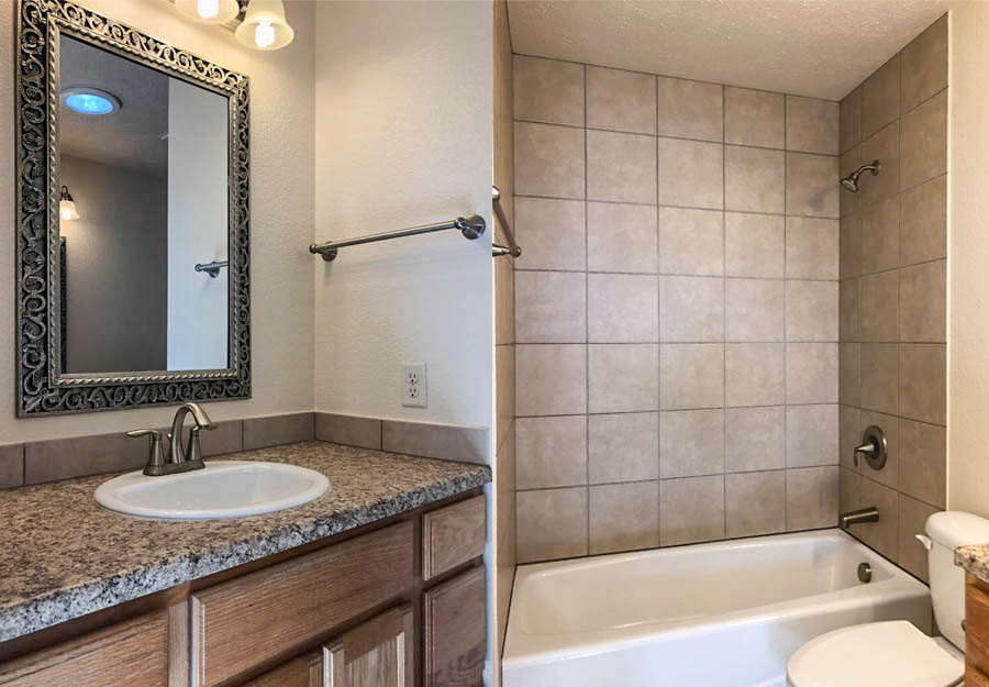 The upstairs bath has an in-tub shower and double vanities!