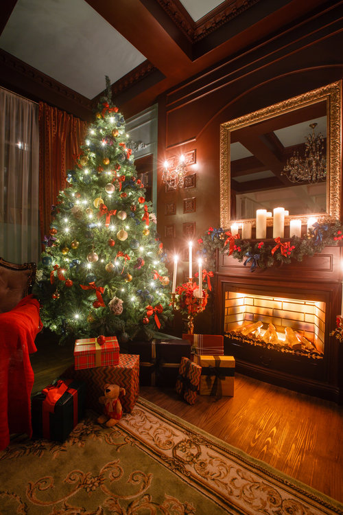 Red Christmas Fireplace - this beautiful room is decorated for Christmas in shades of red, green, and cream.