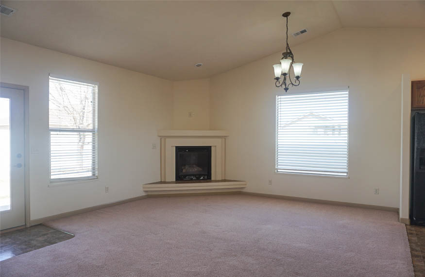 The dining room of 187 Sun Hawk Drive has a gas fireplace in the corner, and access to the back patio.