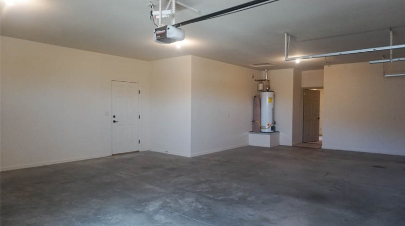 The 3-car garage is slightly oversized & has access to the back yard and RV parking area.