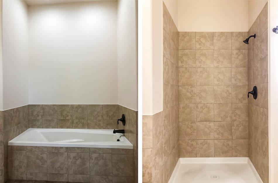 The tub & step=in shower in 170 Sun Hawk Drive's master bathroom