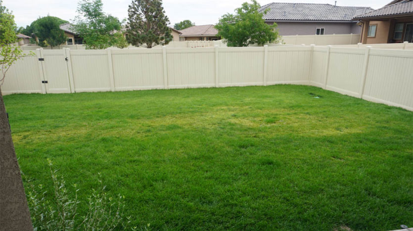 The back yard of 2840 Kelso Mesa has a large grassed area.