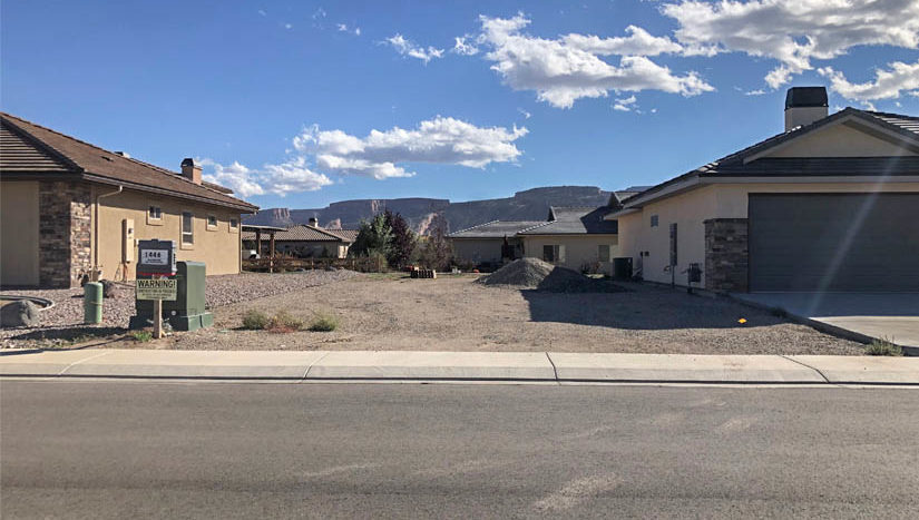 The RV parking area of 1446 Shoreline Drive in Fruita has space for multiple vehicles, and is adjacent to the 4-car garage and locking storage area.