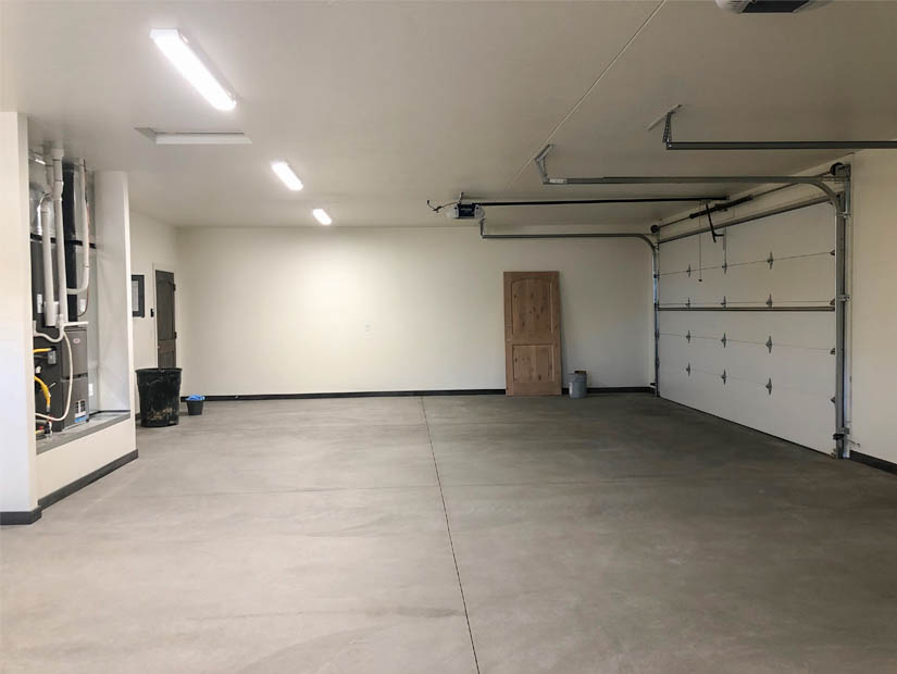 The oversized 4-car garage has two 16'x8' doors, and access to the RV parking anra and attached locking storage room.