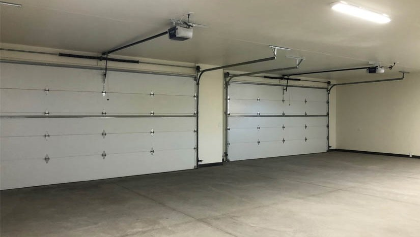 1484 Shoreline Dr has a 4 car garage PLUS an oversized RV parking area and an attached storage area.