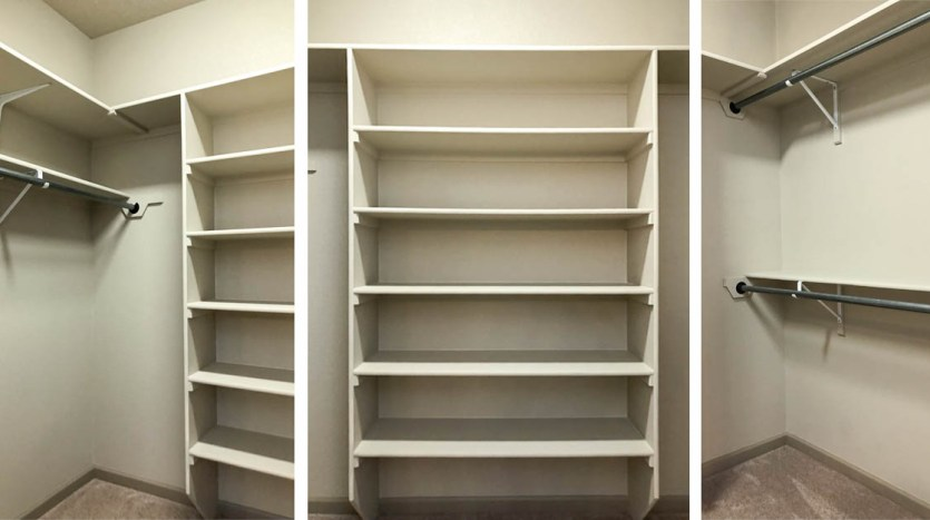 The walk in closet offers shelving and hanging space.