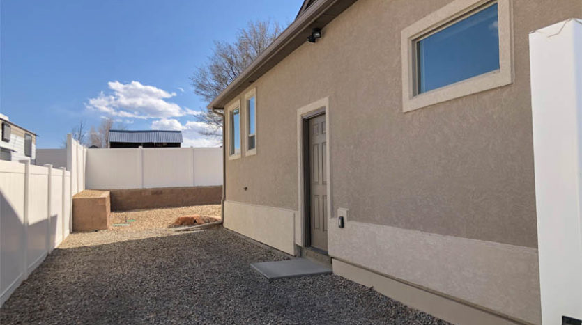 2989 Black Hawk Way has RV parking behind a 10-foot access gate on the east end of the property.