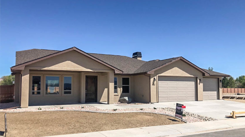 852 Fire Agate Lane - 3 bedrooms, 2 baths, vaulted living & dining room, kitchen appliances included. Bonus storage room attached to outside of home. 3 car garage + RV parking!