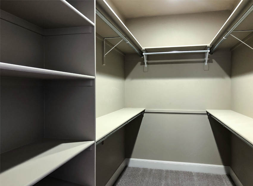 The closet in the master suite has shelving and hanging space.