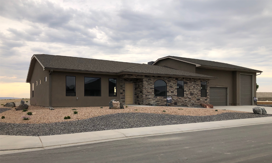 853 Fire Agate Lane is a 3 bedroom, 2 bath home on a corner xeriscaped lot in Emerald Ridge Estates. The main feature of 853 Fire Agate is the built-in 16-foot tall RV garage!