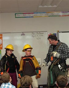 NHEC line worker impresses upon students the importance of electrical safety