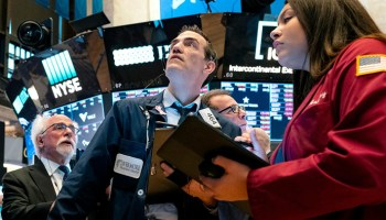 Nasdaq stretches to record highs, lifted by Apple, Amazon