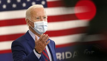 Biden suggests people were able to quarantine because 'some Black woman was able to stack the grocery shelf' in viral clip