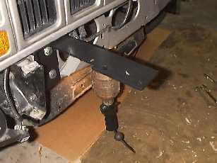 Install the upper winch mount brackets.