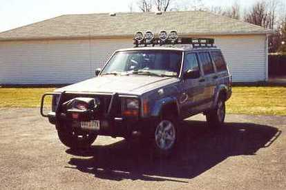 Jeep Cherokee with roof rack.