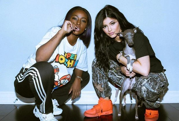 "Justine Skye in the Raf Simons x adidas Response Trail Robot and Kylie Jenner in the Nike Air Yeezy 2 ""Red October"""