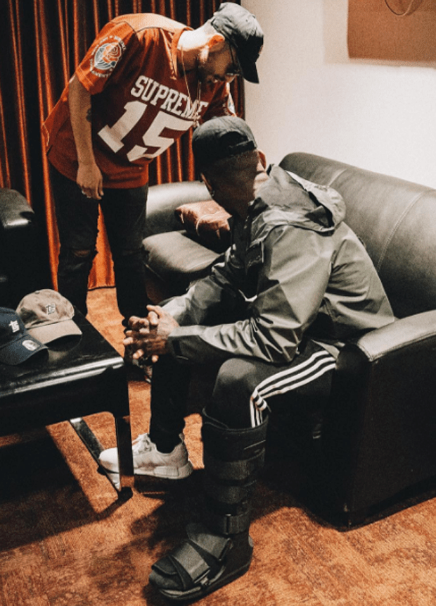 Bryson Tiller in the adidas NMD White/White