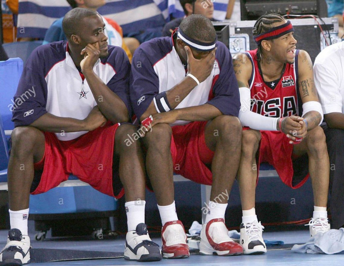 epa000251985 US basketball players Emeka Okafor (L), Amare Stoudemire (C) and Allan Iverson (R) react on the bench as their team is defeated by Puerto Rico in a preliminary group B Basketball match of the Athens 2004 Olympic Games, Sunday 15 August 2004. The US team lost 73-92. epa/ana/dpa Akis Mikoniatis EPA/Akis Mikoniatis
