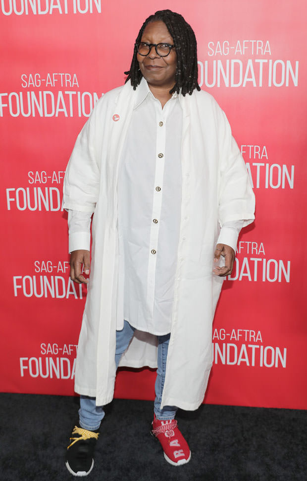 Whoopi Goldberg in mismatched Pharrell x adidas NMDs
