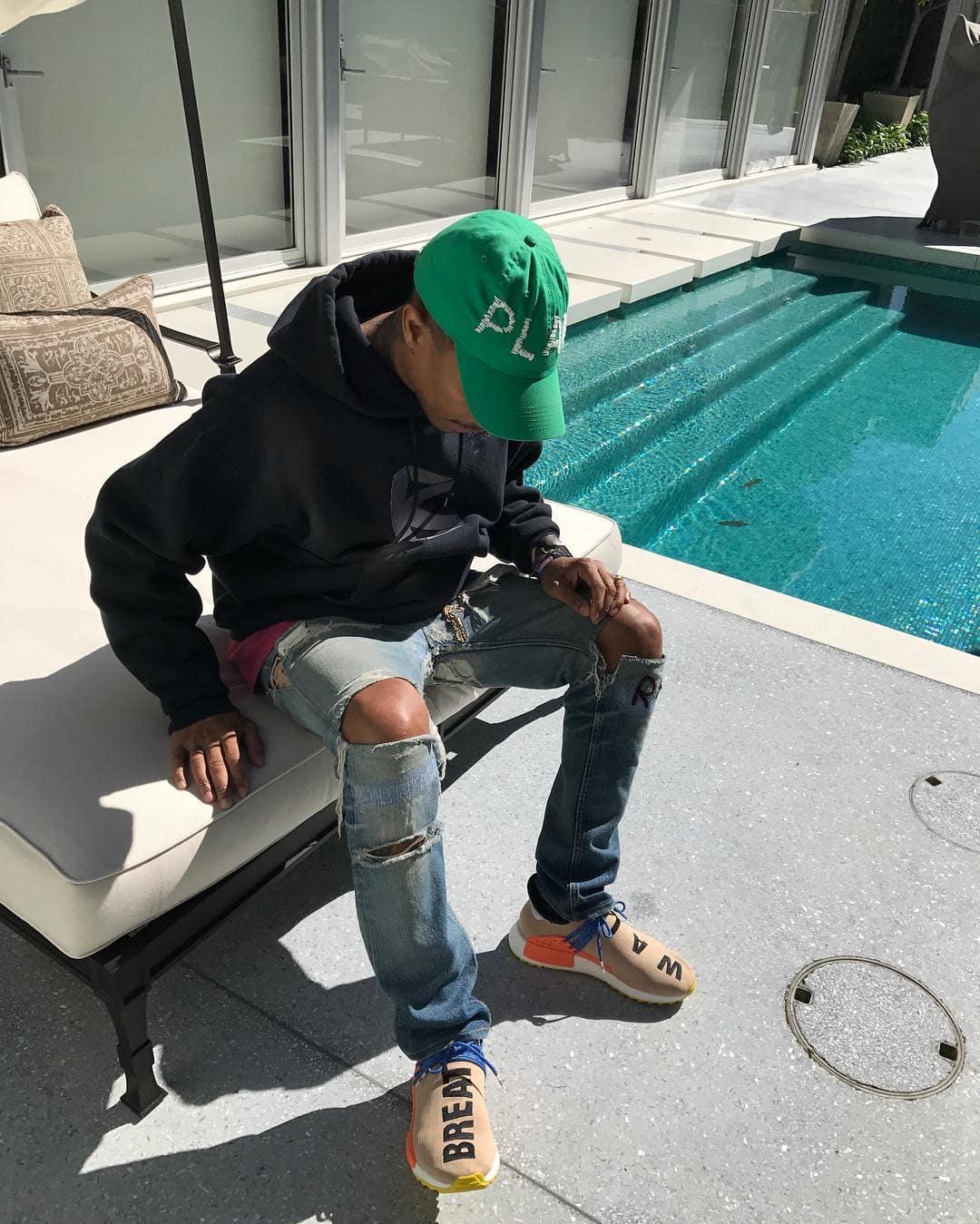 Pharrell in a new Pharrell x adidas NMD