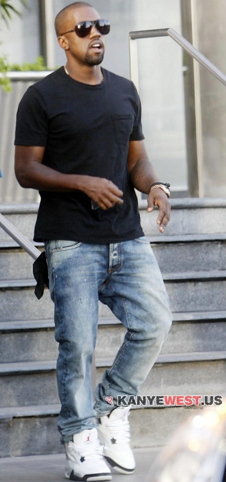 separation shoes 8c8a3 47873 ... Kanye West in the  99 Air Jordan 4 White Cement ...