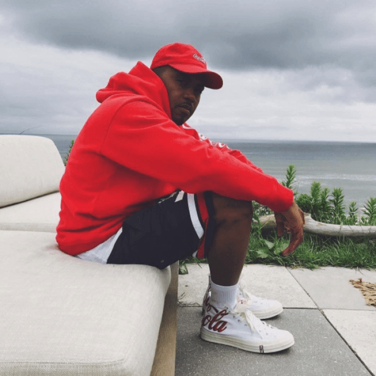 Nas in the Kith x Coca Cola x Converse Sneakers