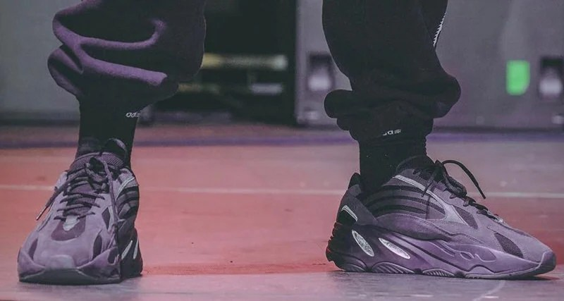 "93313de7dfc Kanye West Dons adidas Yeezy 700 V2 ""Utility Black"" on Stage"