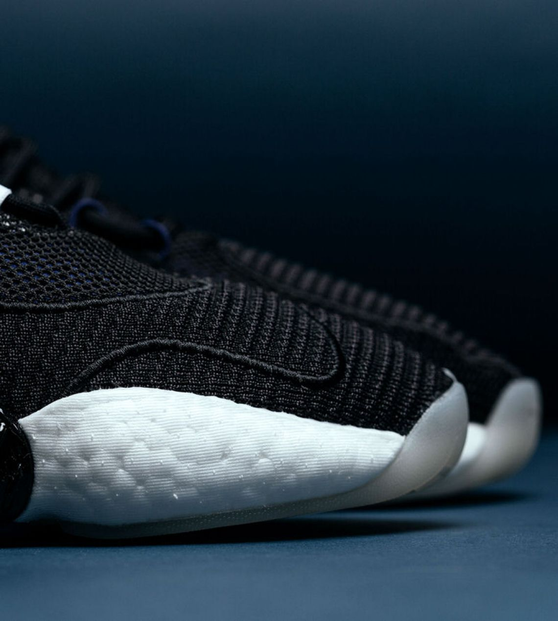 "sports shoes 97d0e cfe17 The Crazy BYW LVL II features a ""Core Black"" mesh upper with a sock-like  collar and a Boost midsole that has an exaggerated arch support. Purple  hues can be ..."