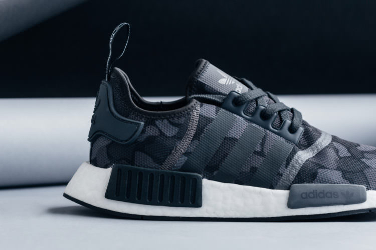 "new product 74986 9f714 Available now, the adidas NMD R1 ""Duck Camo Core Black"" can be copped from  Feature for  130."