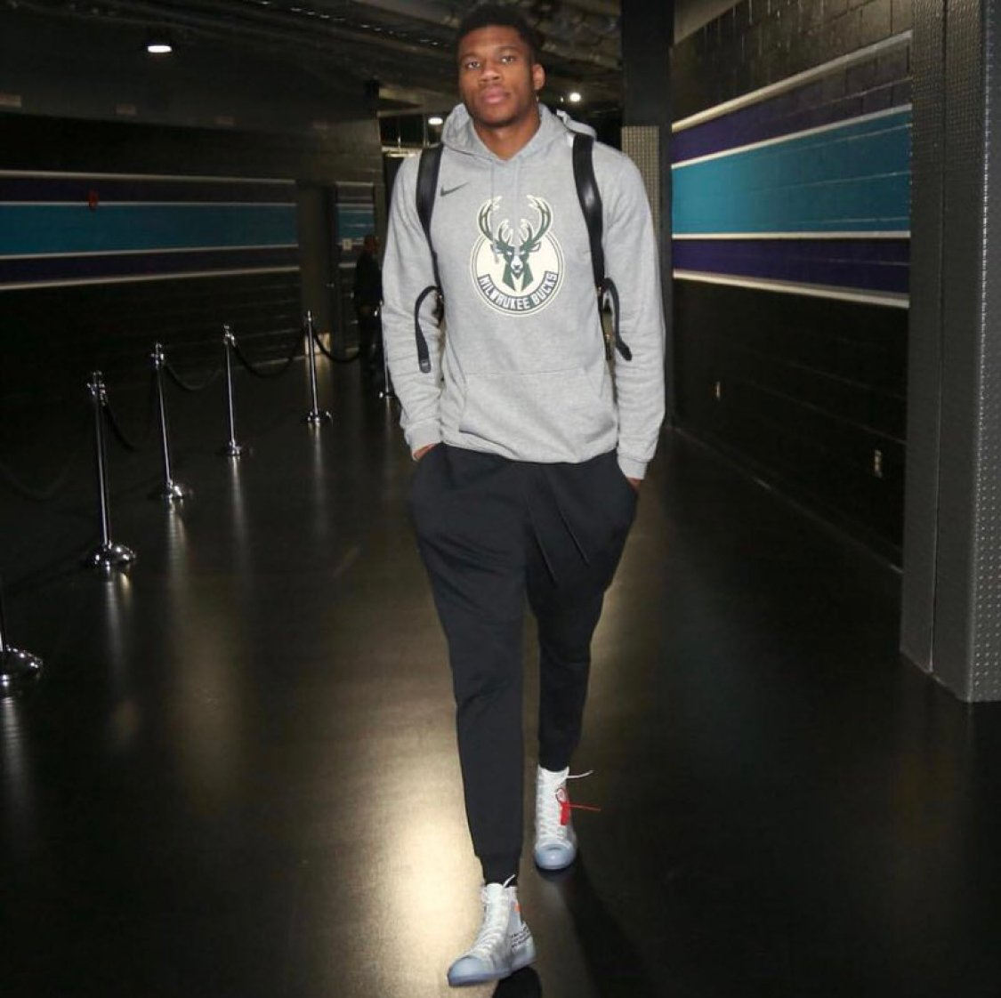 Giannis Antetokounmpo in the Off White x Converse Chuck Taylor