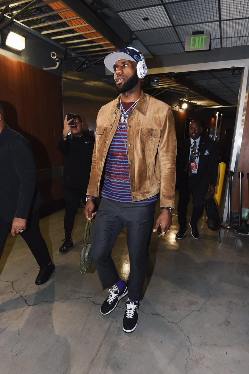 Lebron James in the CDG x Supreme x Nike Air Force 1 Low