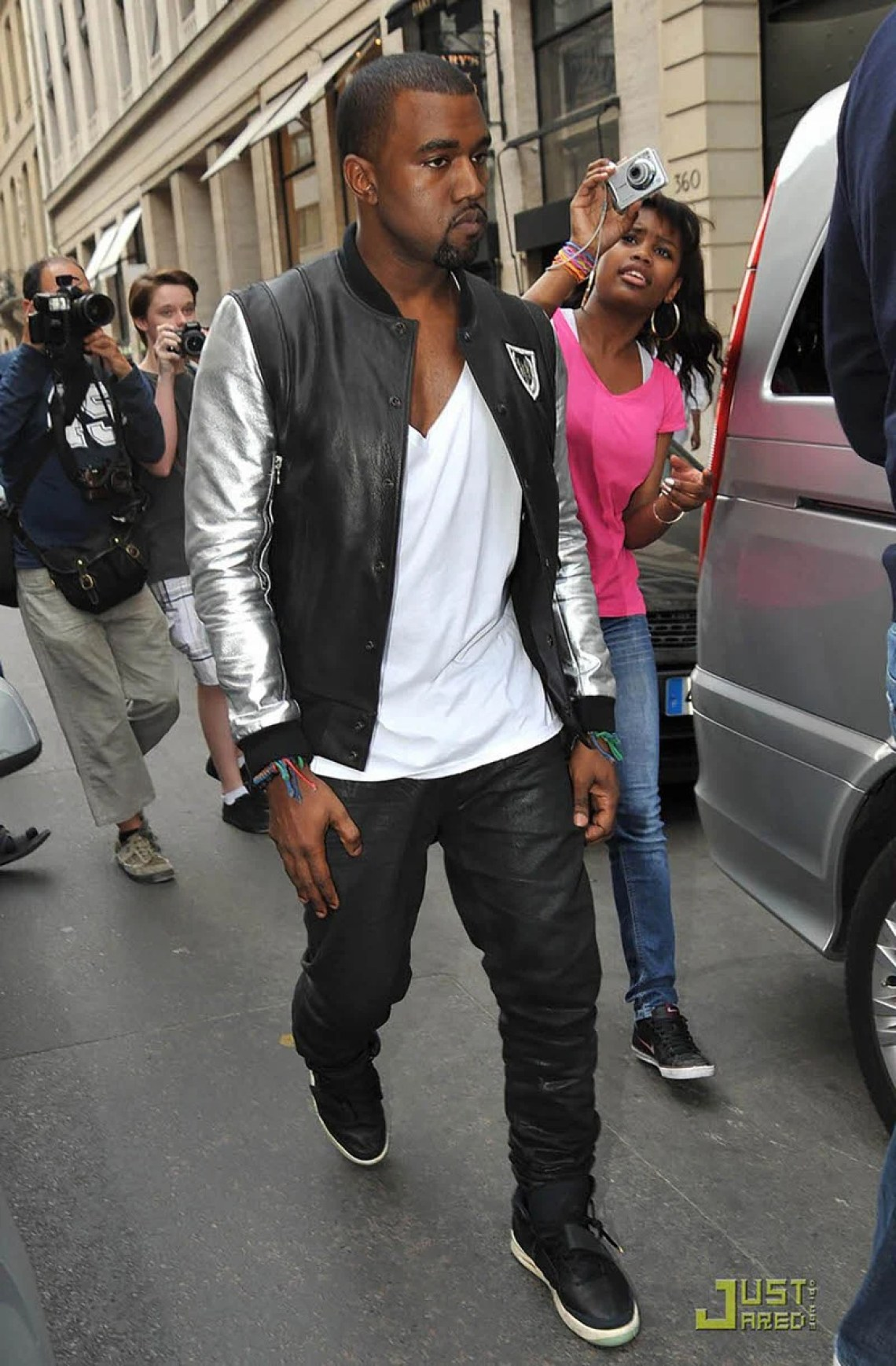 99574ce8eaeee ... Kanye West in the Nike Air Yeezy 2 Prototype ...
