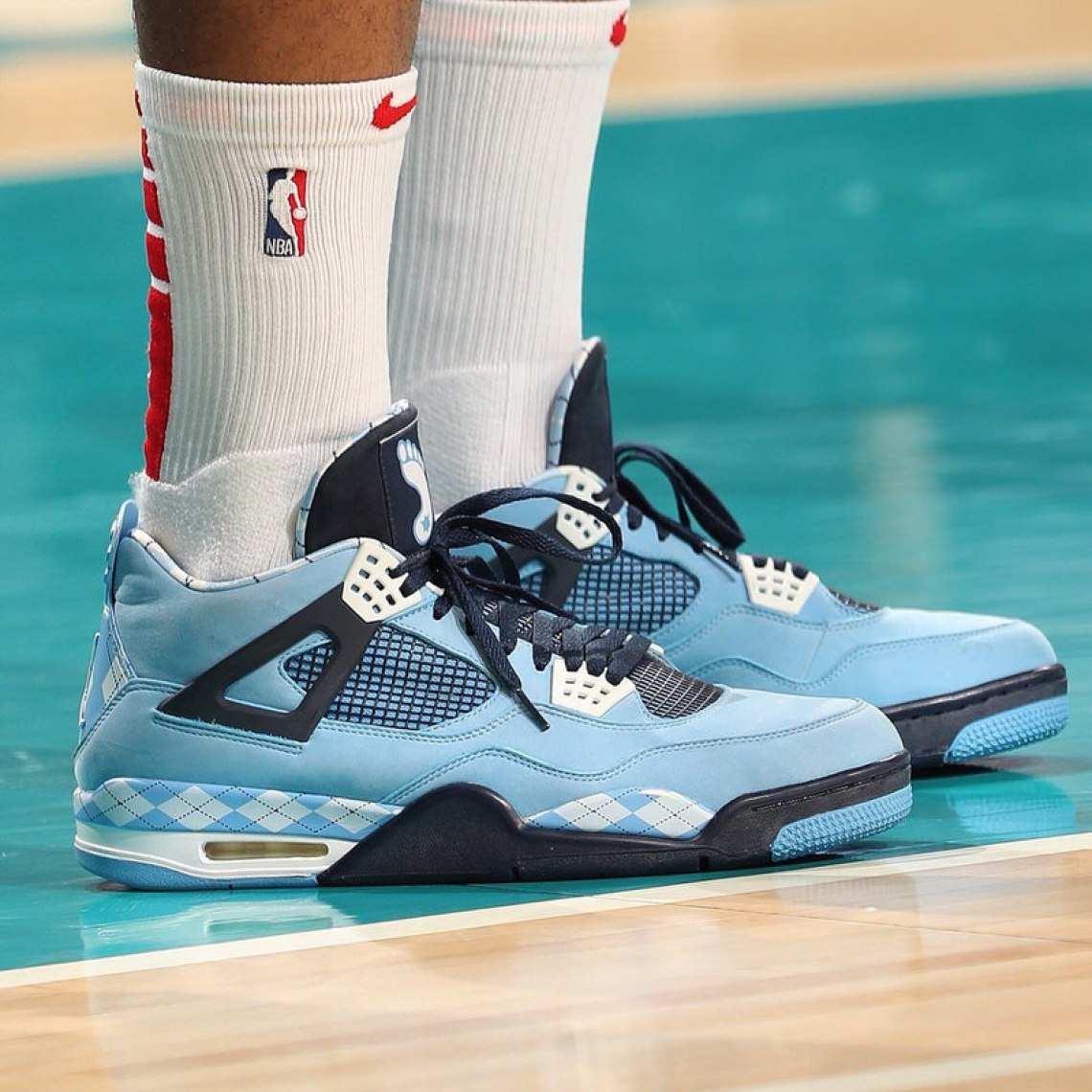 5a61a2512e9 ... PJ Tucker in the Air Jordan 4 North Carolina PE (photo by Kent  Smith/NBAE via Getty Images) ...