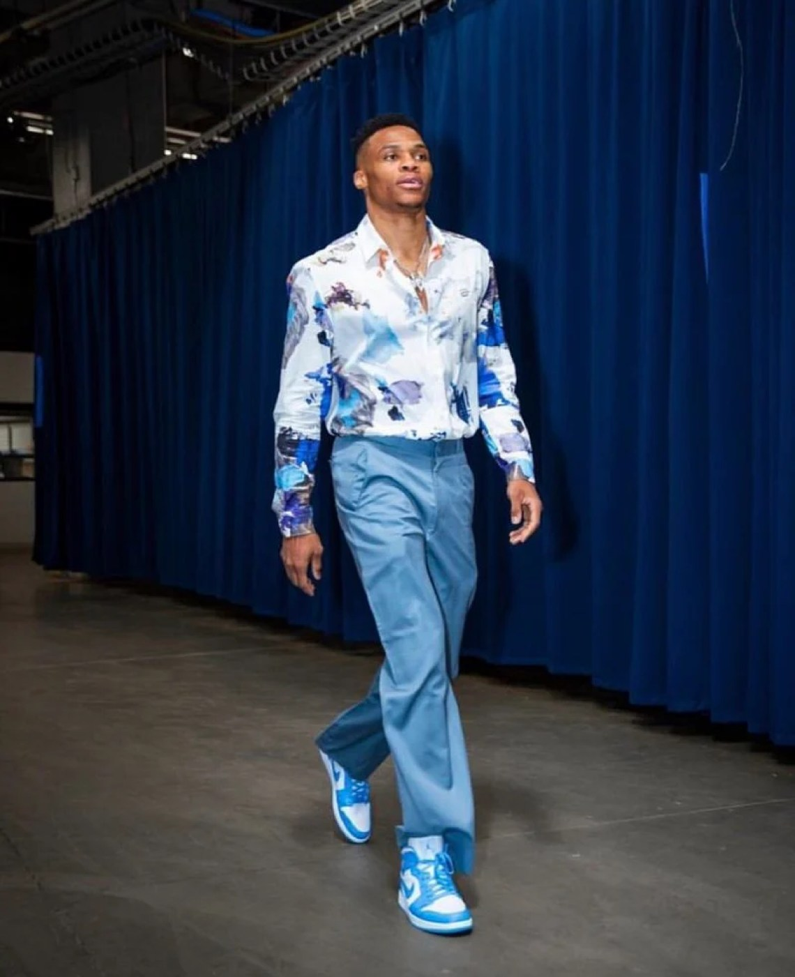 Russell Westbrook loosens up with men's suiting, featuring bright tones, patterns and OFF-WHITE Jordan 1s.