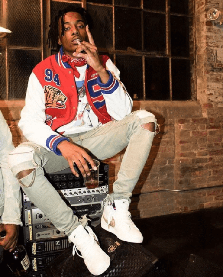 Playboi Carti styles the Supreme x Nike SB Blazer with a letterman look and ripped skinny jeans.