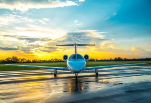 Nicholas Air Citation CJ3 on wet reflective tarmac with sunset background