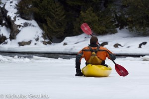 Christian Woodard stoically schooches upstream on Otter Creek in February.