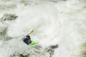 A local paddler from another group plugs the middle of the frothing maw at the top of Fall Creek Rapid. The rest of us went around...
