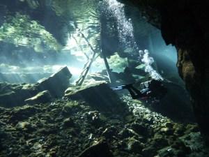 Scuba diver near the exit ladder, Gran Cenote