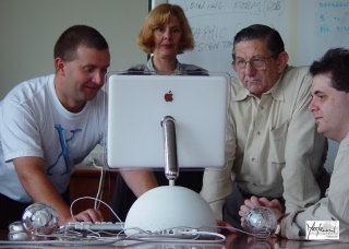 Luke, Susan, Ron and Nicholas with close up of rear of the iMac.