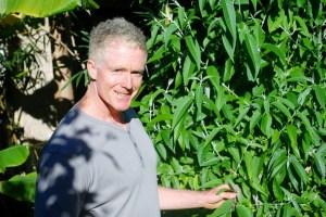Steve McGrane in his backyard garden in Korora